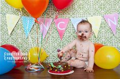 smash cake! shutter love photography $80/session... love the bunting, balloons, background!