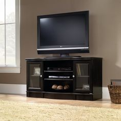 Sauder 412871 Regent Place Panel TV Stand This TV Stand by Sauder comes in an estate black finish. Regent Place Panel TV Stand Accommodates up to a Tv Stand Plans, Black Tv Stand, Tv Stand With Storage, Cool Tv Stands, Frosted Glass Door, Tempered Glass Door, Glass Doors, Tv Stand Models, Houses