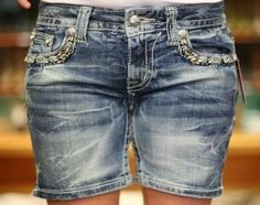 $48 Womens Miss Me Denim Shorts. Embrace the cooler temperatures in these distressed shorts, they are faded 6 inch shorts from Miss Me Jeans. Features stud accents in a medium blue denim wash with distressed, faded areas. And check out those back pockets! Bordered rhinestones and accents and down th...
