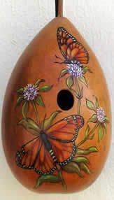 Gorgeous butterfly and floral gourd birdhouse.