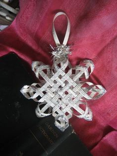 House Revivals: Make a Woven Star from Vintage Book Pages | Wow, isn't this homemade Christmas ornament gorgeous?