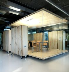 Cube meeting room in warehouse open plan office