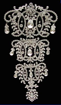"Queen Mary give this 8"" Victorian stomacher to the Queen as a wedding gift in 1947. It is designed as a series of intersecting circles.    It has ten diamond drops and divides horizontally into three separate brooches."