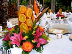 sliced oranges in centerpiece surrounded by tropical flowers. great for a tropical setting wedding. Tropical Centerpieces, Table Centerpieces, Wedding Centerpieces, Table Decorations, Centrepieces, Centerpiece Ideas, Wedding Decoration, Luau Wedding, Wedding Flowers
