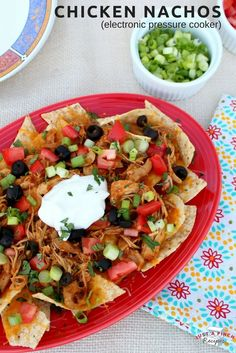 I love the cooking method and ease of this the handy, dandy, electric pressure cooker. It makes the chicken so juicy and tender. The chicken really absorbs all the flavor goodness from the salsas and taco seasoning. These chicken nachos are delicious!