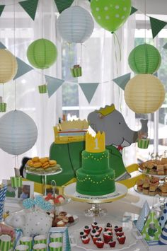 Babar Birthday Party. A little too much green but I love the hot air balloon lanterns & the cake.