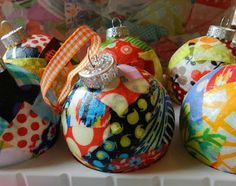 Sew to Speak: Scrappy Ornaments-decoupage squares of fabric with Mod Podge to the outside of glass balls