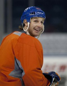 Edmonton Oilers Ryan Smyth smiles after shooting a puck over the boards at assistant coach Kelly Buchberger during a skate at Rexall Place on January 2013 in Edmonton Hockey Rules, Personal Fan, Thanks For The Memories, Edmonton Oilers, Hockey Players, Nhl, Baseball Hats, Husband, January 11