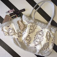 Belyn Design Purse & Makeup Bag Beautiful hand made purse. Used a few times. You can wash & iron to straighten the ruffles. Belyn Design Bags Shoulder Bags