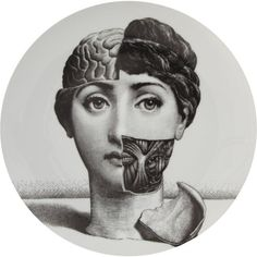 Fornasetti Original Tema e Variazioni Plates designed by Piero Fornasetti, an artist from Milan, Italy. The face is that of nineteenth century operatic soprano Lina Cavalieri whose face he reproduced over 500 times in his life's work series Tema e Variazioni (Themes and Variations).