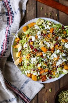 A fresh and clean shaved brussel sprout salad with roasted butternut squash, pomegranate seeds, pumpkin seeds, chopped apple, and feta cheese – all tied together with a citrusy maple cinnamon…