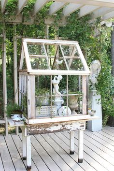 Art and gardens ~ re-purposed windows for mini greenhouse and art spot