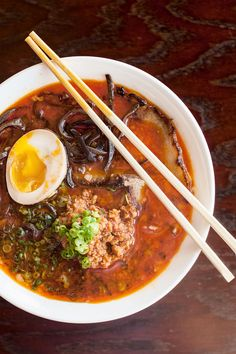 Spoons Up! The 10 Best Ramen Bowls In The Bay #refinery29  http://www.refinery29.com/2013/08/50976/ramen-san-francisco#slide6  Roku Ramen, $11, at Izakaya Roku  Izakaya Roku may only have one ramen on its menu, but let's just say this noodle-filled bowl is all the resto really needs to please our palettes. If the roku ramen looks like the inside of a volcano to you, there's a good reason: It's a fiery, throat-burning bowl thanks to the spicy tonkotsu and rayu oil added in. Beyond the heat…
