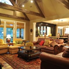 Like the beams, the open concept from living room to kitchen