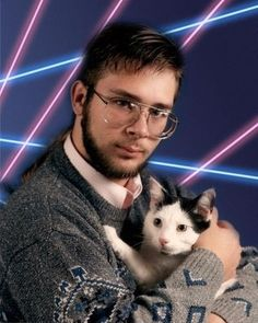 Even the cat looks unnerved by the combination of lasers, knitwear and the hint of a pony tail.