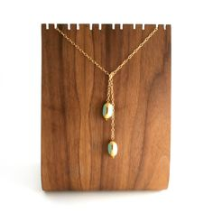 I've been looking for a lariat necklace :) Meg Ryan wears one in Sleepless in Seattle <3  Lariat Necklace Seafoam by LilahV