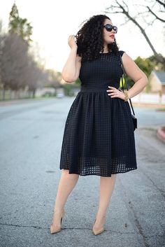 A classic LBD in a glam cut plays to curves while nude heels elongate legs