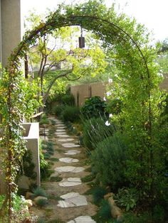 """So pretty. I have the perfect side yard for this design. """"Learn how to cultivate big style in a small garden with these small garden design tips from landscape designer Shirley Bovshow, who transformed this narrow side yard into a charming passageway. Pergola Garden, Backyard Landscaping, Landscaping Ideas, Garden Archway, Walkway Ideas, Garden Entrance, Garden Trellis, Sideyard Ideas, Backyard Ideas"""