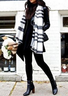 Black from top to toe is every true fashionista's secret weapon. Throw in a bit of preppy appeal by wrapping up in a large plaid scarf for extra style points.