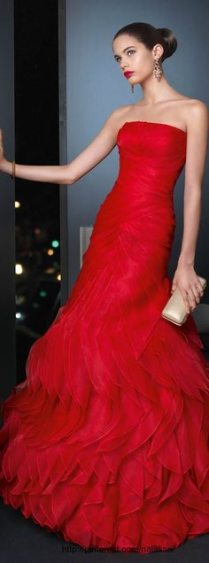 A gorgeous, simplistic red ruffled gown. Emma Watson would look stellar in this.