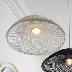 The designer Elise Fouin created an original white suspension with rattan, this model is edited by Forestier's lighting house. The « Satelise »MM has a...
