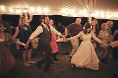 Square Dancing the night away - Definitely more fun than just bouncing to the beat, and it fits a rustic country wedding! :D