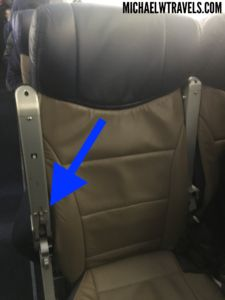 Find out how to increase your space while flying in coach with this secret button.