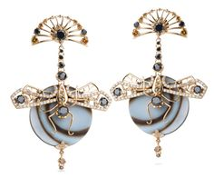 Bochic dragonfly earrings with orange enamel and white diamonds.
