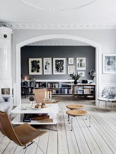 living room, dark black wall, built-in shelves, pale wood