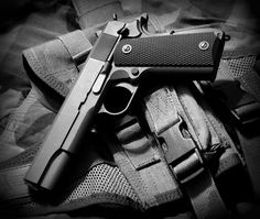 My 1911. HSGI holster in the background. Taken by me a while ago and fiddled with in Picasa just now.