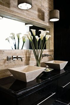 Cool lighting and contemporary styled sinks and faucets out of wall. Unique built-in mirror.