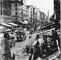 Lower Broadway in New York City, 1859, with the spire of Trinity Church in the background, shows the tall office buildings referred to in Bartleby. Melville presumably conceived of the storys law office as being in the rear of a building of thi