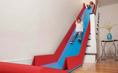 This is the SlideRider, a set of connected folding mats that turn a staircase into a slide. Basically every kid's dream world. The indoor slide is the brainchild of inventor Trisha Cleveland, who is working with Quirky to make. Cleveland, Stair Slide, Indoor Slides, Indoor Slide Stairs, Indoor Playground, Playground Toys, Slide Design, Blog Deco, Deco Design