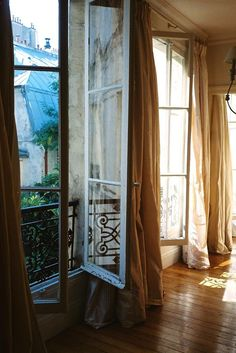 Love the curtains as well as the windows.  (Paris) Perfect windows. obsessed.