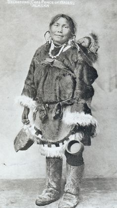 Selaktuna, an Inupiat woman and her baby from Cape Prince of Wales, the Bering Strait, Alaska, circa 1910.