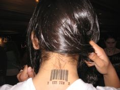 nape of neck tattoos for women | Bar codes are a common back of the neck tattoo.