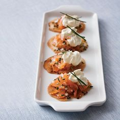 Chef Way Thomas Keller's salmon cornets (tuiles shaped into tiny cones and topped with crème fraîche and fresh salmon) are a famous kickoff to hi...