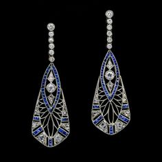 These incredible calibre-cut sapphire and diamond, pierced openwork Art Deco drop earrings, set in platinum on gold