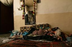 Ababaelie Village, Halabja City, Iraq. Ruqya Abdulrahman was born with serious disabilities in 1978. She always lais down in bed as she can't move her body and she is also not able to talk. There is no treatment for her disabilities. ______________  روقیه كە نهخۆشهیەکی زكماكی هەیەو توشی شهلهل بوهه لە سالی ١٩٧٨ له دایكبووه، ئهو نه دهتوانی ههستێت و نە دهتوانی قسهبكات تەنها دەتوانێ ببینیت.