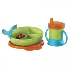 TupperKids™ Feeding Set:  Designed to change with children as they grow. Includes Children's Divided Dish with 3.4 oz./100 mL and 7.6 oz./225 mL sections with removable handle and seal, and 7-oz./200 mL spill-proof sippy cup with removable handle and silicone seal.    www.dakotahdameskitchen.com