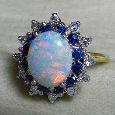Opal Sapphire and Diamond Halo Ring in 14k gold