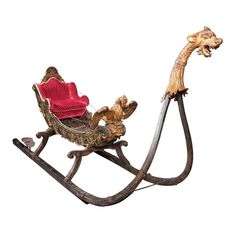Continental Rococo Carved and Painted Ceremonial Sleigh  Probably South German, 18th/19th century  Of carriage form, the padded back and seat with arched rocaille decorated crest.   This was purchased by Mrs. Post and Ambassador Davies during a trip to Venice in 1948.  The C.W. and Marjorie Merriweather Post Collections from Hillwood Estate, Museum & Gardens