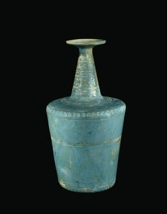 OBJECT NAME  Cylindrical Turquoise Bottle PLACE MADE  probably Iran DIMENSIONS  Overall H: 27.3 cm, Diam (max): 15.5 cm, Diam (rim): 7.8 cm, Weight 701.74 kg DATE  900-1099