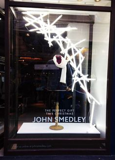 John Smedley's Christmas window on Brook Street comprises a hanging display of LED tubes across two windows and was designed and produced by Tenn Ltd.
