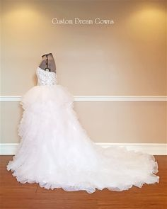Beautiful Custom Ball Gown! Custom Dream Gowns Glamorous Crystal Beaded Organza & Satin Ball Gown with a Sweetheart Neckline, Crystal Beaded & Embroidered Fitted Bodice with Beaded Satin Belt at Natural Waist, Organza Layered Ball Gown Skirt, Chapel Train, Embellished Back with Covered Buttons. #weddingdresses #customweddingdress #ballgown #princess #weddinggown #crystalweddingdress #sayyestothedress #chapeltrain #sweetheart #bride #bridalgowns #affordable #USA #customdreamgowns