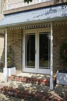 Timber French door with border design astragal bars. Front Porch Addition, Border Design, Windows And Doors, French Doors, Garage Doors, Outdoor Decor, Beautiful, Home Decor, Decoration Home