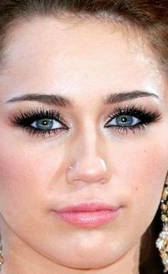 Miley Cyrus. I'm such a fan of her makeup right here. The black makes her blue green eyes stand out.