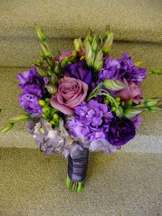 Varying hues of purple ignite this bridal bouquet designed of hydrangeas, lisianthus, stock and more from Bloomtastic Florist!