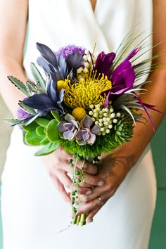 gorgeous succulent and feather bouquet