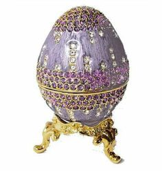Lavender Purple Faberge Egg Ring Box with Swarovski Crystals and Ring Insert Lavender Gold Dazzlers. $49.95. Arrives in a padded, satin lined Presentation Box. 100% Satisfaction Guaranteed by this bonded seller.. This graceful Faberge Egg with separate stand is sure to please. The classical design and 24 karat gold detailing create an exquisite treasure.. Egg opens to reveal a storage compartment that's finished in a glossy enamel. Includes a removable, velvet ring insert...